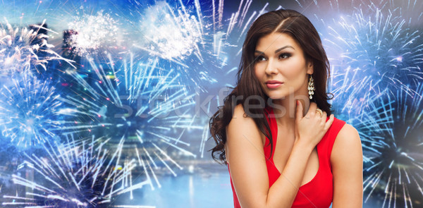 beautiful woman in red over firework at night city Stock photo © dolgachov