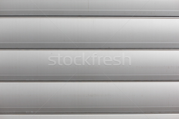 close up of aluminum metal garage door backdrop Stock photo © dolgachov