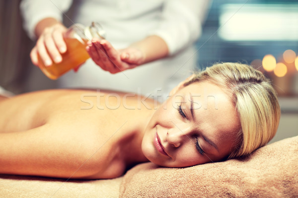 Stock photo: close up of woman lying on massage table in spa