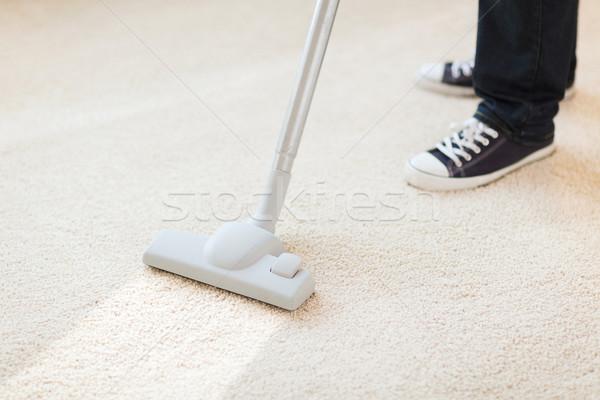 close up of male hoovering carpet Stock photo © dolgachov