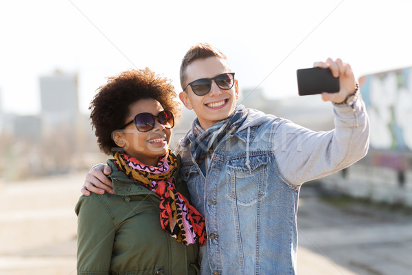 happy teenage friends in shades taking selfie Stock photo © dolgachov