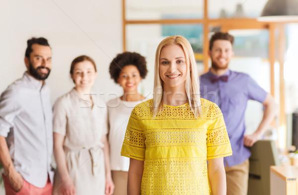 Boldog fiatal nő kreatív csapat iroda üzlet Stock fotó © dolgachov