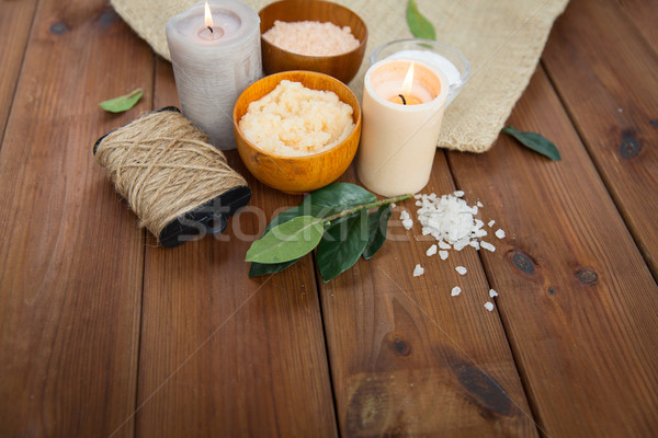 close up of natural body scrub and candles on wood Stock photo © dolgachov