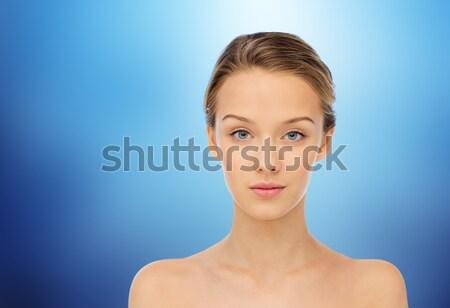 Mulher jovem cara nu ombros azul beleza Foto stock © dolgachov