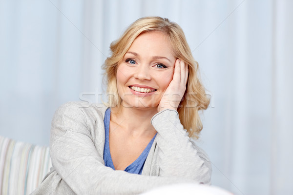 happy middle aged woman at home Stock photo © dolgachov