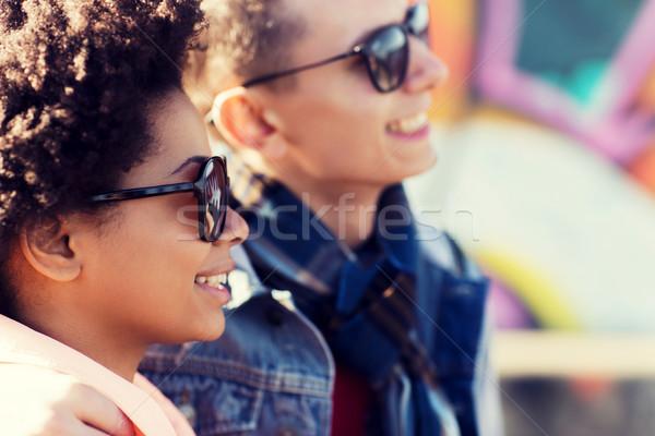happy teenage friends in shades outdoors Stock photo © dolgachov