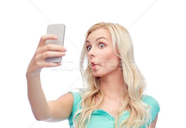 Grappig jonge vrouw smartphone uitdrukkingen technologie Stockfoto © dolgachov