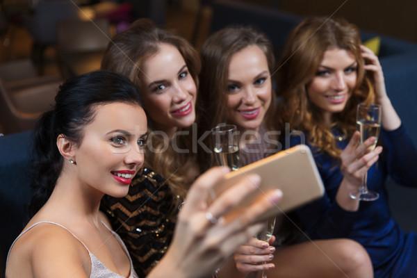 Mulheres champanhe boate celebração amigos Foto stock © dolgachov