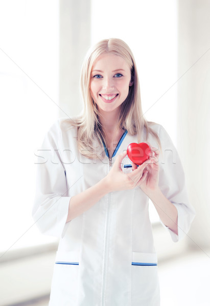 female doctor with heart Stock photo © dolgachov