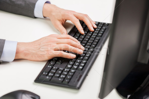 close up of businessman hands typing on keyboard Stock photo © dolgachov