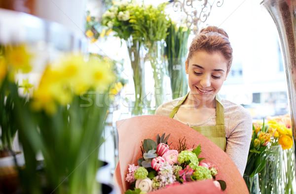 Sorridere fiorista donna persone Foto d'archivio © dolgachov