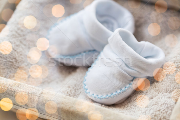close up of baby bootees for newborn boy in basket Stock photo © dolgachov
