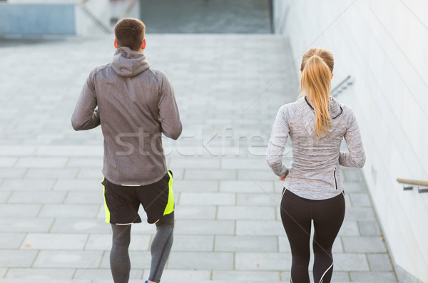 couple running downstairs on city stairs Stock photo © dolgachov
