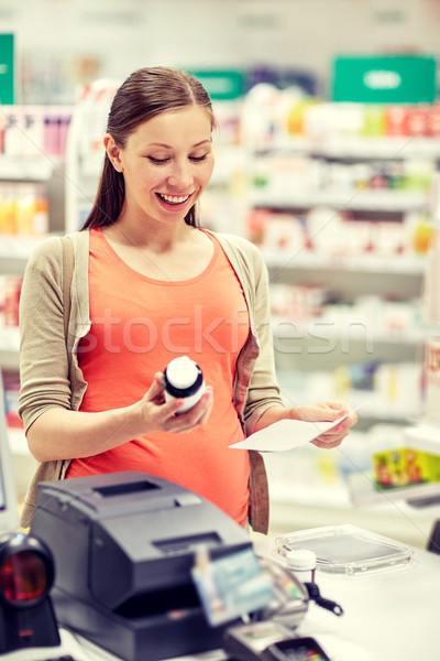 Stock photo: happy pregnant woman with medication at pharmacy