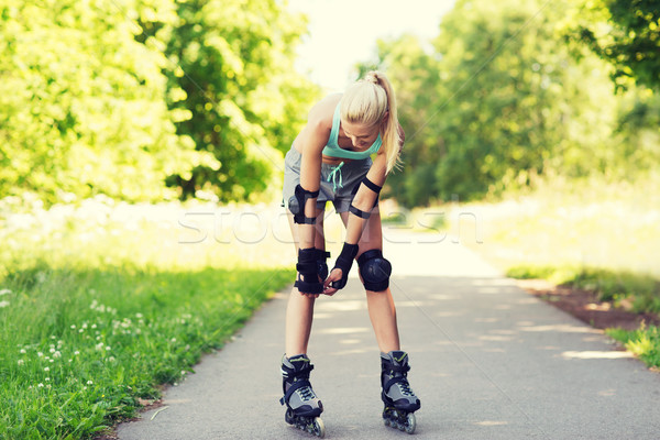 happy young woman in rollerskates riding outdoors Stock photo © dolgachov