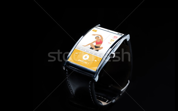close up of smart watch with fitness app on screen Stock photo © dolgachov