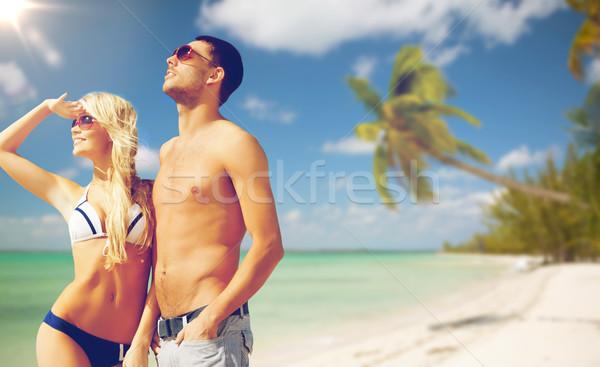 happy couple over exotic tropical beach background Stock photo © dolgachov