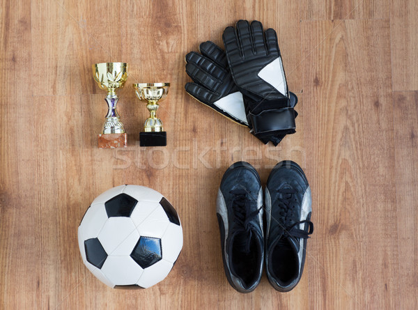 soccer ball, boots, goalkeeper gloves and cups Stock photo © dolgachov