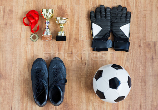 ball, football boots, gloves, cups and medal Stock photo © dolgachov
