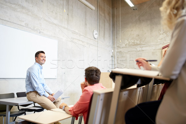 group of students and teacher at lecture Stock photo © dolgachov