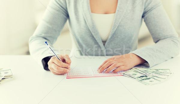 Donna lotteria biglietto soldi business Foto d'archivio © dolgachov