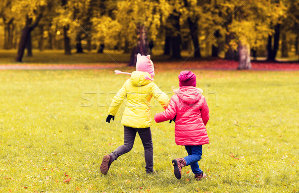 happy little girls running outdoors Stock photo © dolgachov