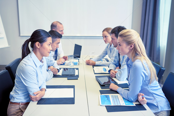 smiling business people having conflict in office Stock photo © dolgachov