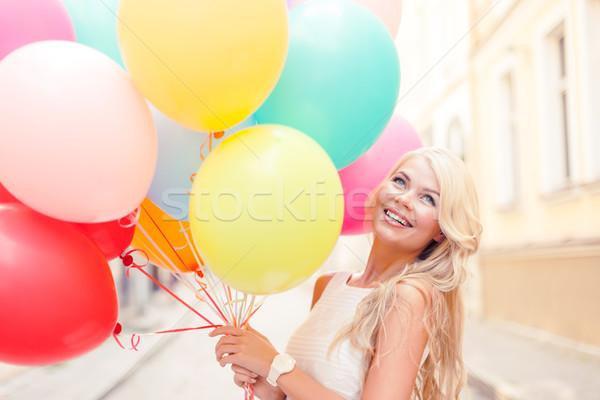 Mosolygó nő színes léggömbök nyár ünnepek ünneplés Stock fotó © dolgachov