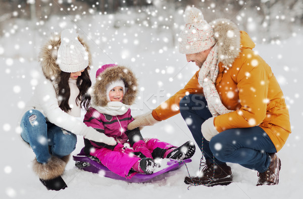 happy family with sled walking in winter forest Stock photo © dolgachov