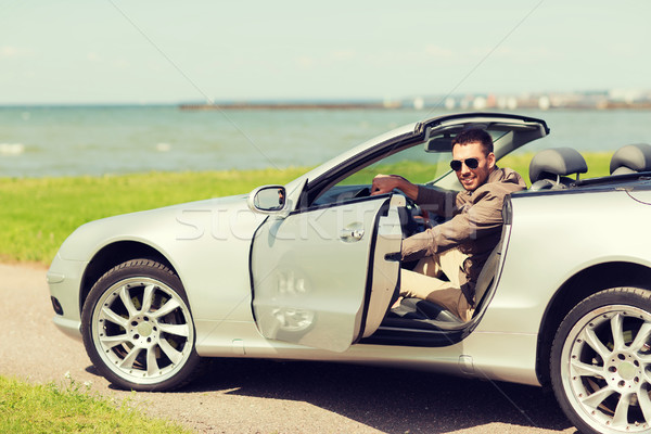 happy man opening door of cabriolet car outdoors Stock photo © dolgachov