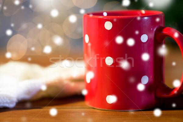 Piros pötty teáscsésze fa asztal ünnepek karácsony Stock fotó © dolgachov