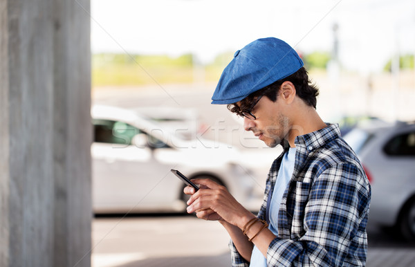 hipster man texting message on smartphone Stock photo © dolgachov