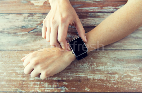 close up of hands setting smart watch Stock photo © dolgachov