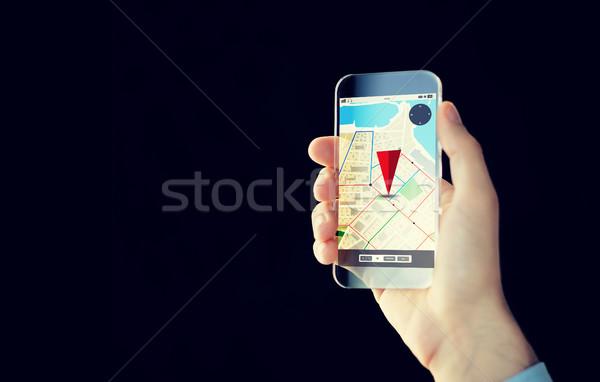Homme main transparent smartphone personnes Photo stock © dolgachov
