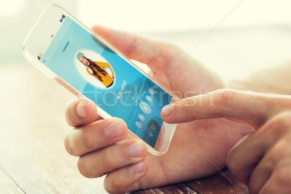 Hand muziekspeler smartphone technologie moderne Stockfoto © dolgachov