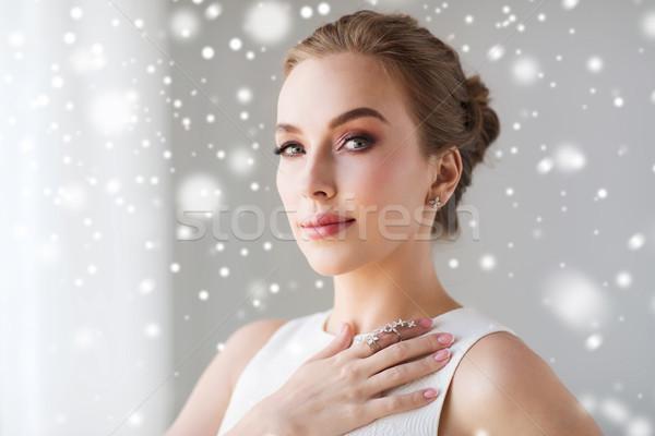 Stock photo: beautiful woman in white with diamond jewelry