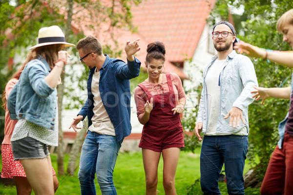 Boldog barátok tánc nyár buli kert Stock fotó © dolgachov