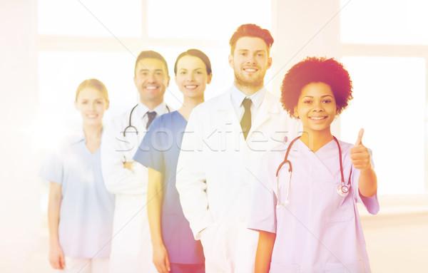 group of happy doctors at hospital Stock photo © dolgachov