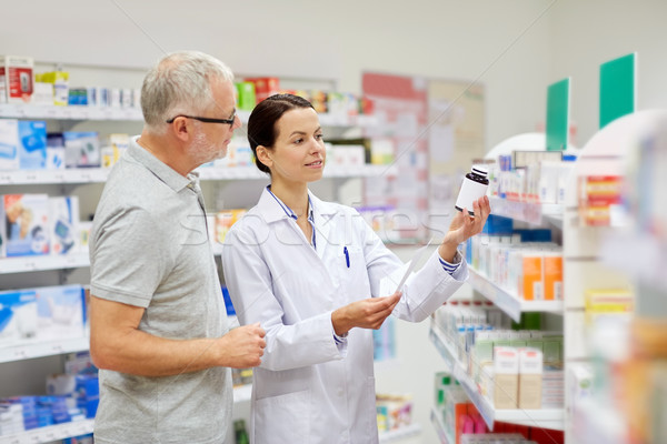 pharmacist and senior man buying drug at pharmacy Stock photo © dolgachov