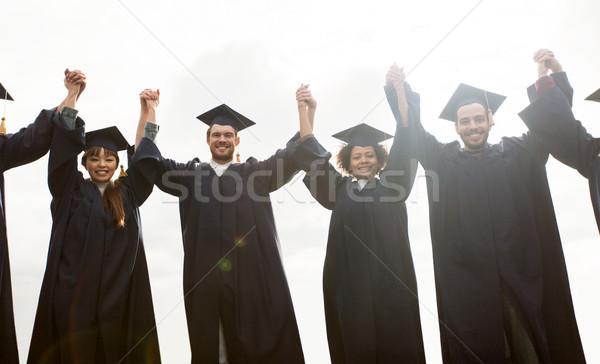 Gelukkig studenten bachelors vieren afstuderen onderwijs Stockfoto © dolgachov