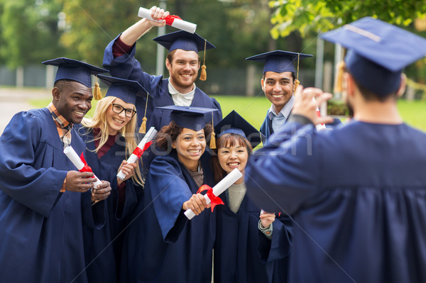 Stock photo: students or bachelors photographing by smartphone