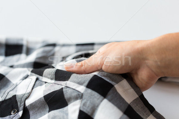 close up of hand with checkered clothing item Stock photo © dolgachov