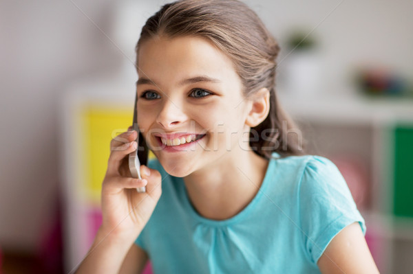close up of girl calling on smartphone at home Stock photo © dolgachov