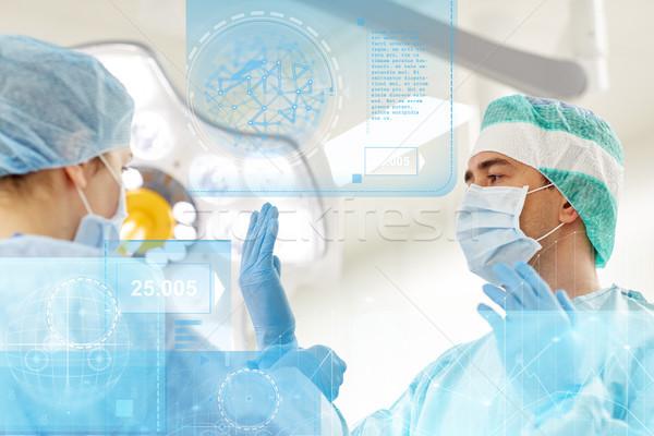 Cirujanos sala de operaciones hospital cirugía salud medicina Foto stock © dolgachov