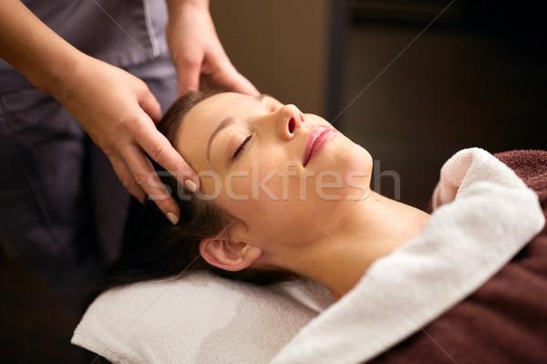 woman having head massage at spa Stock photo © dolgachov