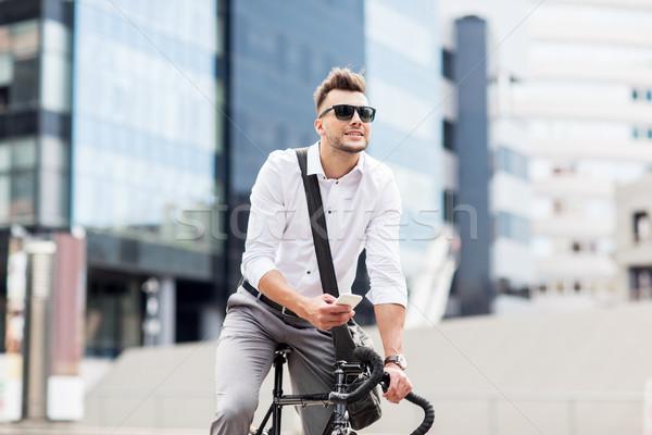 男 自転車 スマートフォン 街 ライフスタイル 輸送 ストックフォト © dolgachov