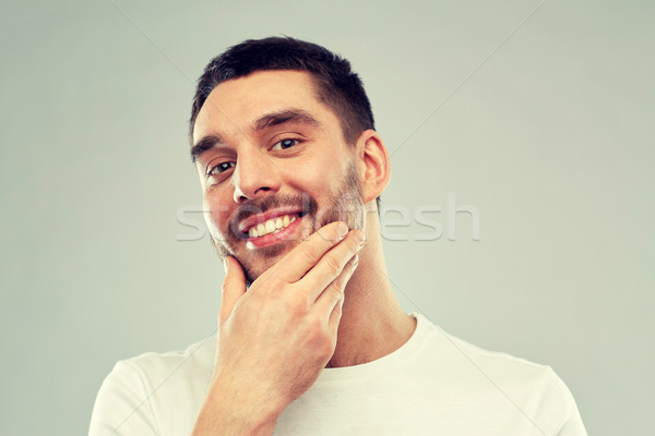 Gelukkig jonge man aanraken gezicht baard schoonheid Stockfoto © dolgachov