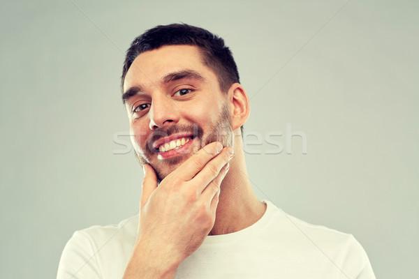Feliz moço tocante cara barba beleza Foto stock © dolgachov