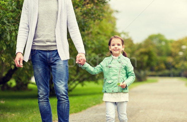 close up of father and little girl walking in park Stock photo © dolgachov