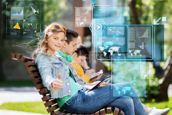 Mutlu genç kız açık havada teknoloji Internet Stok fotoğraf © dolgachov
